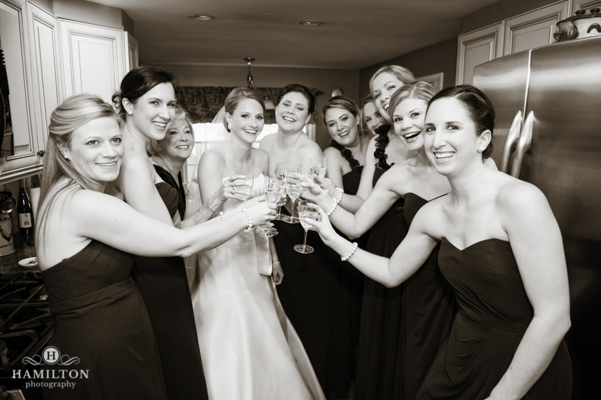 bride and bridesmaids toast