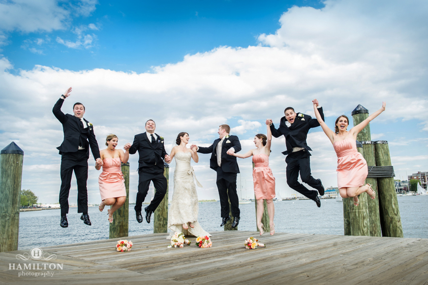Wedding Party Jumps On A Pier
