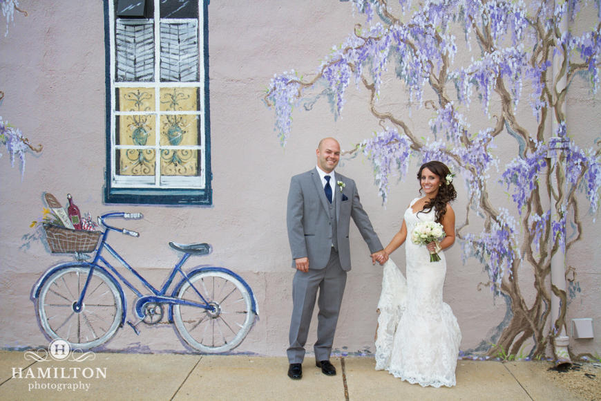 Wedding Couple Pose in Front of Mural