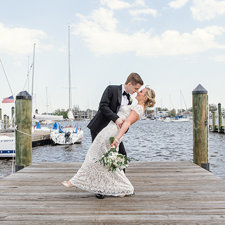 bride and groom on city docks in Annapolis md